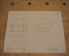 Scale drawing of an angled art deco inspired chair with side book storage
