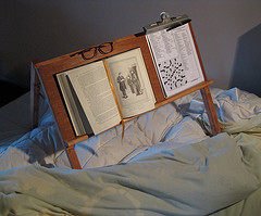 bed easel allows reading and writing while propped up in bed