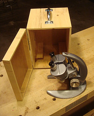 Storage cabinet for a dissecting microscope