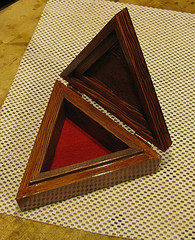 triangle shaped wood box with red mahogany finish