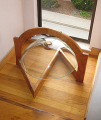 arch suspension of an inverted glass sink bowl.