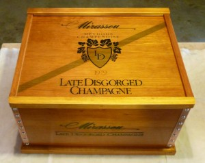The SuperSmythe Mirassoui Wine Crate in its glorious After portrait - the inside bottom is lined with red felt.
