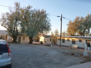 This is the view from our veranda (slab).  That's the blockhouse on the right, and a couple of the shacks straight on.